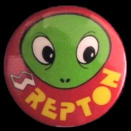 A REPTON badge given away with AROUND THE WORLD IN 40 SCREENS